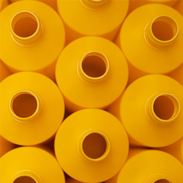 Top down view of empty yellow bottles | Cedesa